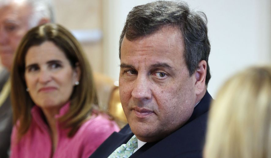 New Jersey Gov. Chris Christie and his wife Mary Pat (left) listen to Melissa Crews during a stop at the Farnum Center in Manchester, N.H., on May 7, 2015. (Associated Press) **FILE**
