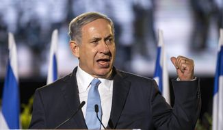 Israeli Prime Minister Benjamin Netanyahu delivers a speech during a ceremony honouring World War II veterans and marking the 70th anniversary of the Allied victory over Nazi Germany at the Armoured Corps Memorial and Museum at Latrun Junction near Jerusalem, Thursday May 7, 2015. (Jack Guez/Pool Photo via AP)