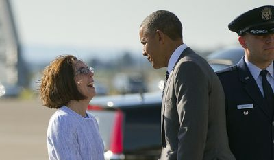 President Barack Obama, right, is greeted by Oregon Gov. Kate Brown, left, on the tarmac during his arrival on Air Force One, Thursday, May 7, 2015, at Oregon Air National Guard Base in Portland, Ore. On Friday, the president will visit Nike headquarters in Beaverton, Oregon, to make his trade policy pitch as he struggles to win over Democrats for what could be the last major legislative push of his presidency. But in choosing the giant sneaker and athletic wear company as his backdrop, Obama has stirred a hornet's nest. (AP Photo/Pablo Martinez Monsivais)