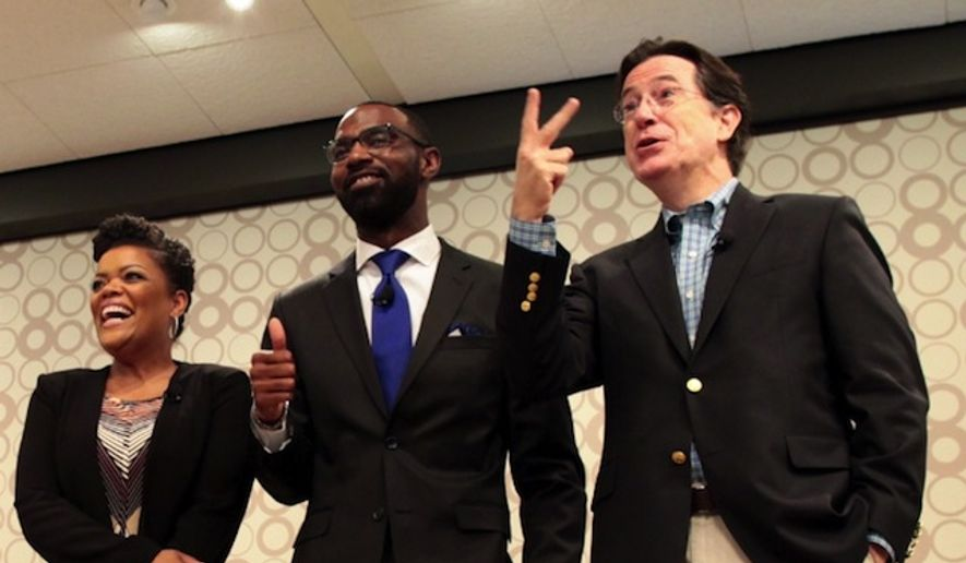 Stephen Colbert joins Yvette Nicole Brown and Damon Qualls, teacher at Alexander Elementary School in Greenville, South Carolina, to announce the funding of nearly 1,000 classroom projects from South Carolina on DonorsChoose.org. (PRNewsFoto/DonorsChoose.org)