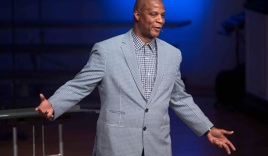 In this April 24, 2015, photo former baseball player Darryl Strawberry gives a sermon in Bear, Del. His promising career was derailed by drug addiction, domestic violence, tax woes and a bout with a cancer. Mr. Strawberry is on a new path these days, speaking with his wife from the pulpit and spreading his story of redemption.  (AP Photo/Suchat Pederson)
