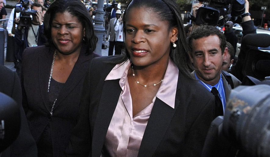 File-This Oct. 1, 2007, file photo shows former New York Knicks executive Anucha Browne Sanders  exiting Manhattan federal court in New York. Sanders won an $11.5 million harassment suit against  Isiah Thomas, the Garden and chairman Jim Dolan in 2007. Thomas, the former Knicks president and coach, was hired this week by Dolan as president of the WNBA's New York Liberty. (AP Photo / Louis Lanzano, File)