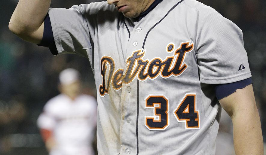 Detroit Tigers' James McCann reacts after being tagged out at first base during the ninth inning of a baseball game against the Chicago White Sox, Wednesday, May 6, 2015, in Chicago. The White Sox won 7-6. (AP Photo/Nam Y. Huh)