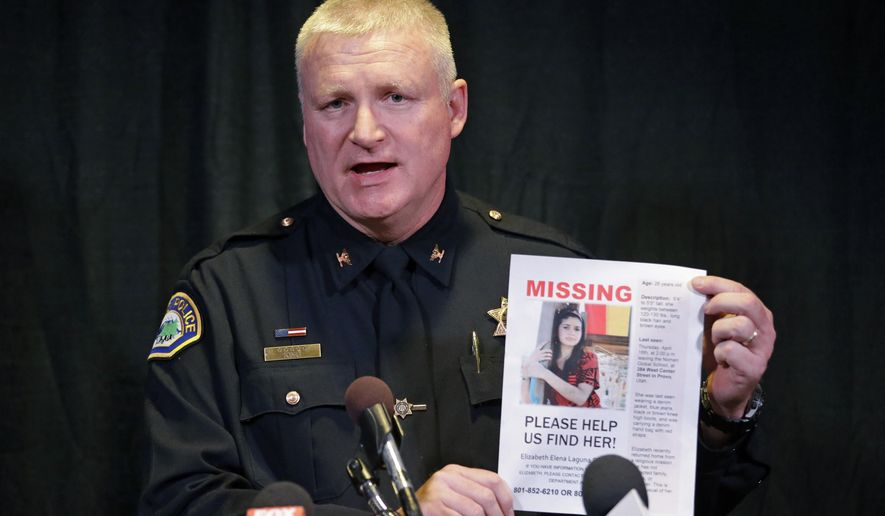 FILE - This April 24, 2015, file photo, Provo Police Chief John King holds a photo of Elizabeth Elena Laguna Salgado during a news conference, in Sandy, Utah. Provo police are offering a $15,000 reward for information that helps them find Salgado, a 26-year-old Mexican woman who was studying in Utah and has been missing for three weeks. She has not been seen since she left class at the Nomen Global Language Center in downtown Provo the afternoon of April 16. (AP Photo/Rick Bowmer, File)