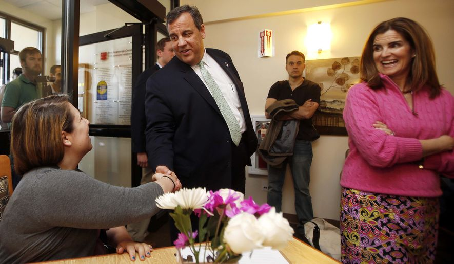 Stephanie Rhodes, left, shake hands with New Jersey Gov. Chris Christie, R-N.J., accompanied by his wife Mary Pat, as they arrive for a roundtable discussion at the Farrnum Center, Thursday, May 7, 2015, in Manchester, N.H. (AP Photo/Jim Cole)
