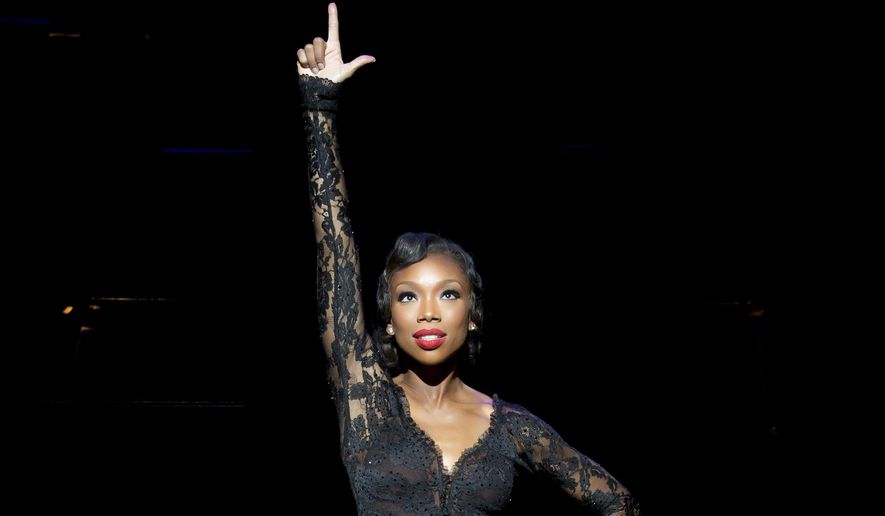 """This image released by Boneau/Bryan-Brown shows Brandy Norwood in the role of Roxie Hart during a performance of the musical """"Chicago"""" at the Ambassador Theatre in New York. Brandy will portray Hart through June 21. (Jeremy Daniel/Boneau/Bryan-Brown via AP)"""