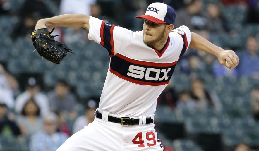 Chicago White Sox starter Chris Sale throws a pitch against the Detroit Tigers during the first inning of a baseball game in Chicago on Wednesday, May 6, 2015. (AP Photo/Nam Y. Huh)