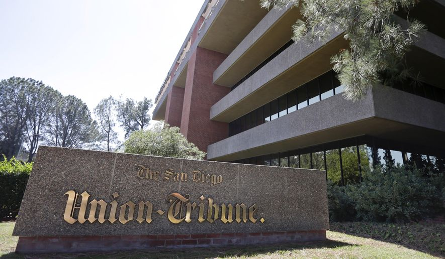 FILE - This Sept. 23, 2014, file photo shows the building housing the U-T San Diego newspaper, formerly known as the San Diego Union-Tribune, in San Diego. Tribune Publishing, which also publishes the Los Angeles Times in Southern California as well as other properties nationwide, has agreed to buy San Diego's dominant newspaper for $85 million, U-T San Diego reported Thursday, May 7, 2015. (AP Photo/Gregory Bull, File)