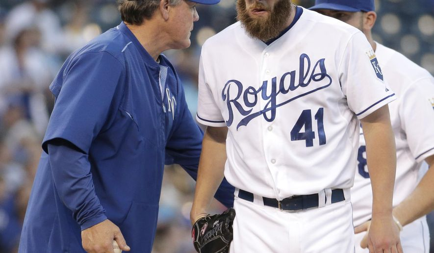 Kansas City Royals starting pitcher Danny Duffy walks to the dugout after being replaced by manager Ned Yost during the second inning of a baseball game against the Cleveland Indians, Wednesday, May 6, 2015, in Kansas City, Mo. (AP Photo/Charlie Riedel)