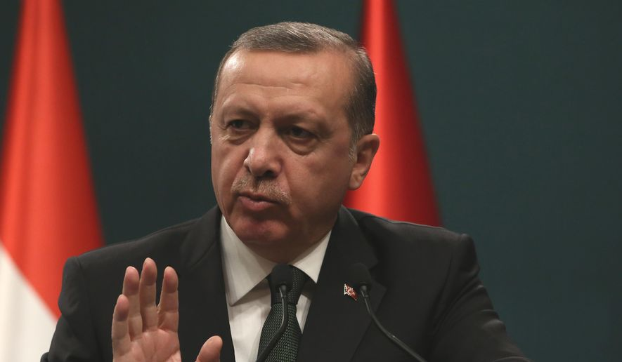 Turkish President Recep Tayyip Erdogan speaks to the media during a press conference in Ankara, Turkey, in this Thursday, March 12, 2015, file photo. (AP Photo/Burhan Ozbilici, file)