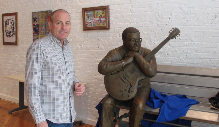 This April 14, 2015 photo shows Jay Sieleman, president and CEO of The Blues Foundation, next to a statue of blues musician Little Milton at the Blues Hall of Fame museum in Memphis, Tenn. The foundation raised nearly $3 million for the museum, which is set to open Friday, May 8, in Memphis. (AP Photo/Adrian Sainz)