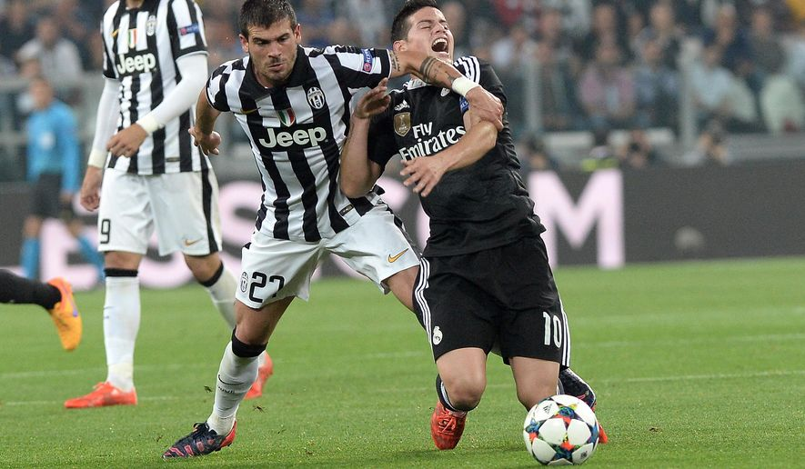 Real Madrid James Rodriguez, right, vies for the ball with Juventus' Stefano Sturaro during the Champions League, semifinal soccer match between Juventus and Real Madrid at the Juventus Stadium in Turin, Italy, Tuesday, May 5, 2015. (AP Photo/Massimo Pinca)