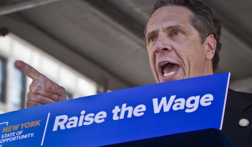 Gov. Andrew Cuomo speaks during a labor rally, announcing a plan to get a minimum  $15 an hour wage hike for fast-food workers, Thursday, May 7, 2015, in New York. Cuomo is proposing a plan to get a minimum wage hike that doesn't require legislative approval. Cuomo said he will direct the state labor commissioner to examine the minimum wage in the fast-food industry. (AP Photo/Bebeto Matthews)