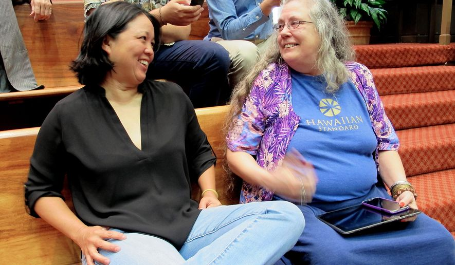 Jari Sugano, left, and Teri Heede attend a Hawaii Legislature session, Thursday, May 7, 2015, in Honolulu. Sugano's daughter and Heede are among the state's estimated 13,000 patients who could benefit from legislation to create a system of medical marijuana dispensaries. (AP Photo/Cathy Bussewitz)
