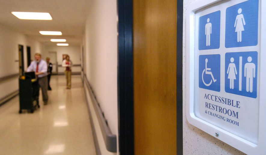 A new sign designates a third floor unisex restroom at a Kent State University student center in Kent, Ohio. (Associated Press)