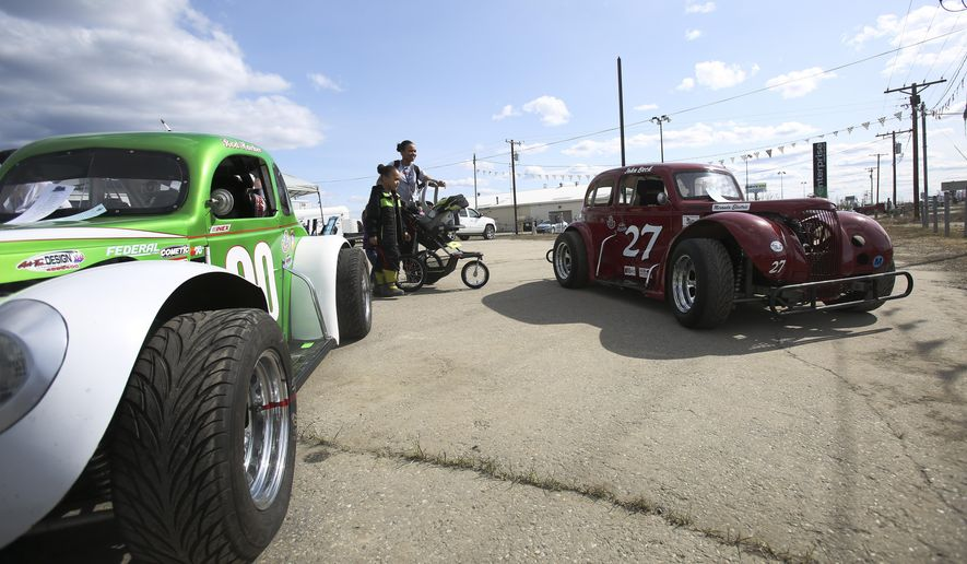 Domenique Reeves, 5, and his mother Chanique Wilson look at legend cars during the Interior Alaska Motorsports Car Show at American Tire in Fairbanks, Alaska on Sunday, May 3, 2015.  ( Erin Corneliussen/The Fairbanks Daily News-Miner via AP) MANDATORY CREDIT