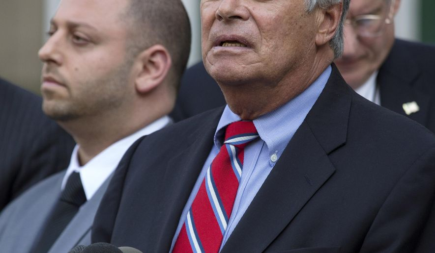 FILE- In this May 4, 2015 file photo, New York Senate Majority Leader Dean Skelos, right, speaks alongside his son Adam after their arraignment on federal charges including extortion and soliciting bribes. Dean Skelos, who was born, raised and still lives in Rockville Centre, said that despite growing pressure for him to resign, he is getting strong support from his Long Island neighbors. (AP Photo/Craig Ruttle, File)