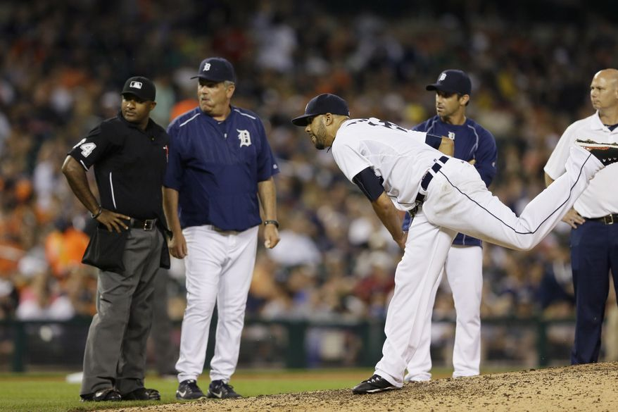 Detroit Tigers starting pitcher David Price throws as home plate umpire Alan Porter, left, Detroit Tigers pitching coach Jeff Jones and manager Brad Ausmus observe during the seventh inning of a baseball game against the Kansas City Royals, Friday, May 8, 2015, in Detroit. Price was relieved. (AP Photo/Carlos Osorio)