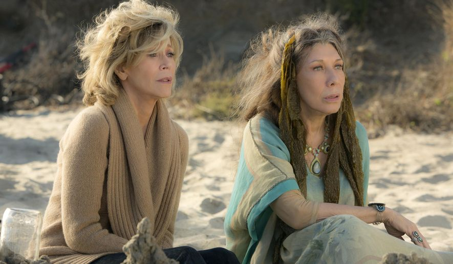 "This photo provided by Netflix shows Jane Fonda, left, and Lily Tomlin in the Netflix Original Series ""Grace and Frankie,"" premiering on Friday, May 8, 2015.  (Melissa Moseley/Netflix via AP)"