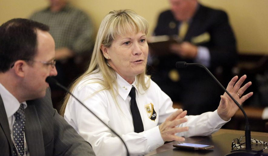 Krista Dunn, Salt Lake City Police deputy chief speaks during the Administrative Rules Review Committee meeting Friday, May 8, 2015, in Salt Lake City. Utah lawmakers discussed Friday whether police officers in the state should receive more training about how to deescalate encounters with people undergoing mental health crises. The hearing was the a second study session held as lawmakers take a hard look at law enforcement practices in the state following recent civilian deaths at the hands of police around the country. (AP Photo/Rick Bowmer)