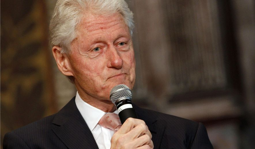 FILE - In this April 21, 2015 file photo, former President Bill Clinton listens to a question after speaking at Georgetown University in Washington. Clinton, Oprah Winfrey, Howard Stern and Julia Roberts will be among the guests during the final full week of David Letterman's reign as a late-night host. Letterman's final show will be on May 20. (AP Photo/Jacquelyn Martin, File)