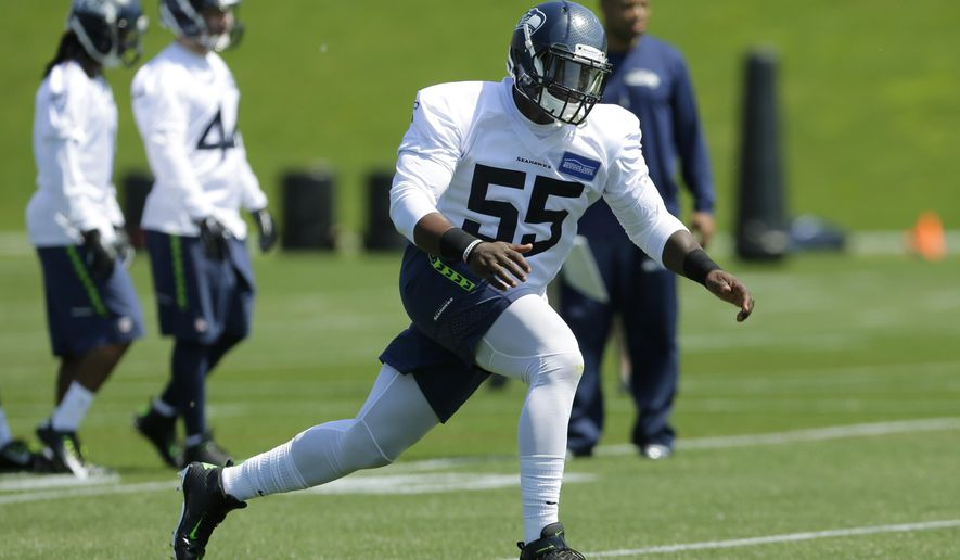 Seattle Seahawks rookie defensive end Frank Clark (55) runs a drill during NFL football rookie minicamp, Friday, May 8, 2015, in Renton, Wash. (AP Photo/Ted S. Warren)