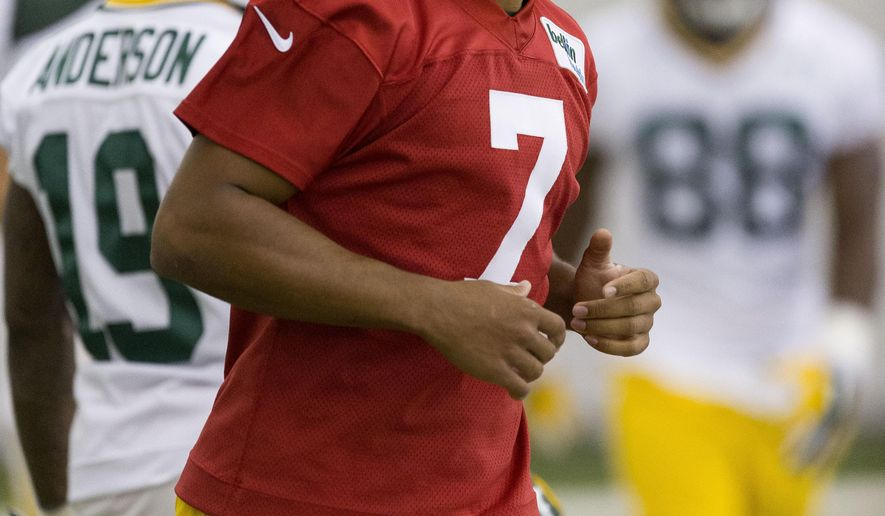 Green Bay Packers fifth round draft pick Brett Hundley smiles during NFL football minicamp Friday, May 8, 2015 in Green Bay, Wis.   (AP Photo/Mike Roemer)
