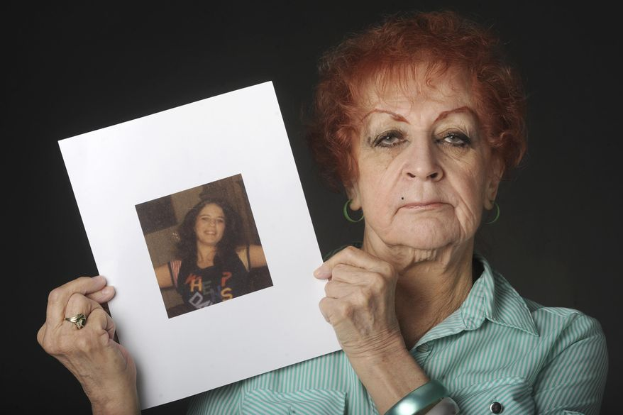 ADVANCE FOR SUNDAY MAY 10, 2015 AND THEREAFTER- In this photo taken April 26, 2015, Judy Connolly holds a photograph in Anchorage, Alaska, that was taken just days before her 16-year-old daughter Shelley Connolly was found dead in 1978. On a foggy Saturday morning in early January 1978, the body of a 16-year-old girl was found in a ditch off the Seward Highway. An autopsy would later determine she had been beaten, sexually assaulted, dragged behind a car and then tossed down an embankment. (Bill Roth/Alaska Dispatch News via AP)