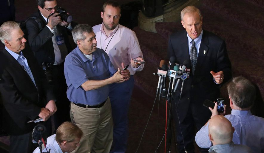 Illinois Gov. Bruce Rauner, at podium, comments on the Illinois Supreme Court decision that the Illinois pension law is unconstitutional, Friday, May 8, 2015, in Chicago. The court struck down a 2013 law that sought to fix the nation's worst government-employee pension crisis, a ruling that forces the state to find another way to overcome a massive budget deficit. The decree puts Rauner and Democrats who control the General Assembly back at the starting line in trying to figure out how to wrestle down a $111 billion deficit in what's necessary to cover its state employee retirement obligations. (Antonio Perez/Chicago Tribune via AP)