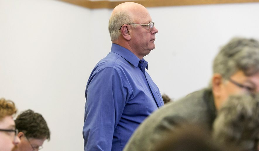 Vermont state Sen. Norman McAllister stands during arraignment in court Friday, May 8, 2015, in St. Albans, Vt., where he pleaded not guilty to several charges of sexual assault and prohibited acts that prosecutors said involved three victims. (Gregory J. Lamoureux/Pool Photo via AP)