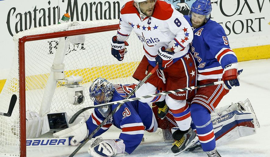 Washington Capitals left wing Alex Ovechkin (8) watches the rebound on a shot attempt against New York Rangers goalie Henrik Lundqvist (30) and New York Rangers defenseman Dan Girardi (5) during the first period of Game 5 in the second round of the NHL Stanley Cup hockey playoffs, Friday, May 8, 2015, in New York. (AP Photo/Julie Jacobson)