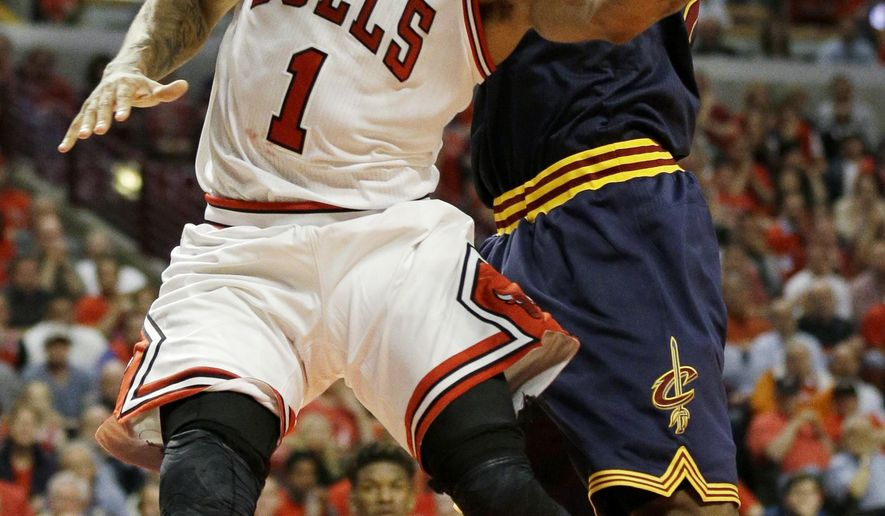 Chicago Bulls guard Derrick Rose (1) drives to the basket past Cleveland Cavaliers forward LeBron James during the second half of Game 3 in a second-round NBA basketball playoff series in Chicago on Friday, May 8, 2015. (AP Photo/Nam Y. Huh)