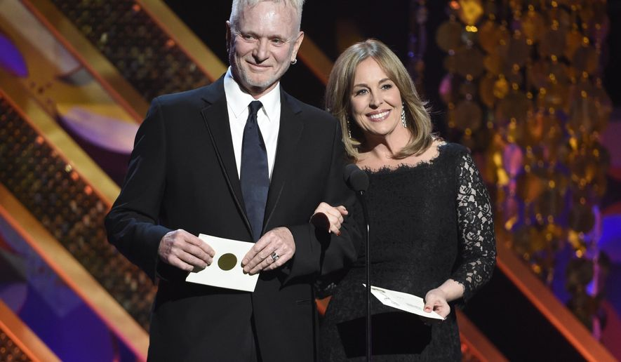 """FILE - In this April 26, 2015 file photo, Anthony Geary, left, and Genie Francis present the award for outstanding drama series at the 42nd annual Daytime Emmy Awards in Burbank, Calif. Geary is leaving """"General Hospital,"""" the soap opera where he has played the character of Luke Spencer for nearly three decades. Frank Valenti, the show's executive producer, said Friday, May 8, it was Geary's decision to leave. He will be written out of the show for an episode that will air on the ABC daytime drama this summer. Francis, who played Laura to Geary's Luke for many years but left the show two years ago, will briefly return to participate in Geary's exit. Their 1981 wedding on """"General Hospital"""" was a huge television event. (Photo by Chris Pizzello/Invision/AP, File)"""