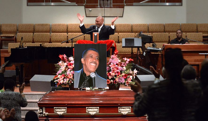 "The Rev. Dr. Lester Taylor, Jr. sings during a memorial for local legendary soul singer Ben E. King at the Community Baptist Church in Englewood, N.J., Thursday, May 7, 2015. King, the unforgettable lead singer for the Drifters and solo star whose plaintive baritone graced such pop and rhythm 'n blues classics as ""Stand by Me,"" ''There Goes My Baby"" and ""Spanish Harlem,"" died April 30. He was 76. (Carmine Galasso/The Record of Bergen County via AP) ONLINE OUT; MAGS OUT; TV OUT; INTERNET OUT;  NO ARCHIVING; MANDATORY CREDIT"