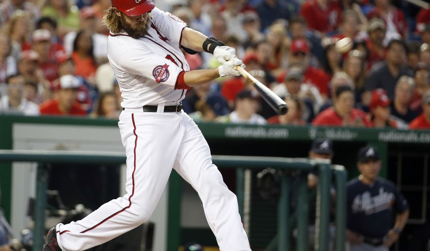 Washington Nationals' Jayson Werth (28) hits a solo home run during the fourth inning of a baseball game against the Atlanta Braves at Nationals Park, Friday, May 8, 2015, in Washington. (AP Photo/Alex Brandon)