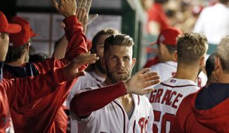 Washington Nationals' Bryce Harper (34) celebrates his three-run homer during the eighth inning of a baseball game against the Atlanta Braves at Nationals Park, Friday, May 8, 2015, in Washington. Harper had two homers in the game. The Nationals won 9-2. (AP Photo/Alex Brandon)