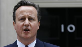 Britain's Prime Minister David Cameron speaks to the media outside 10 Downing Street in London, Friday, May 8, 2015. (AP Photo/Kirsty Wigglesworth) ** FILE **