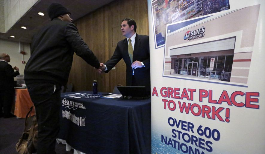 In this April 22, 2015, file photo, a sign at a recruiting station for Leslie's Pool supplies boasts that it is a great place to work during a National Career Fairs job fair, in Chicago. The Labor Department released employment data for April on Friday, May 8, 2015. (AP Photo/M. Spencer Green)