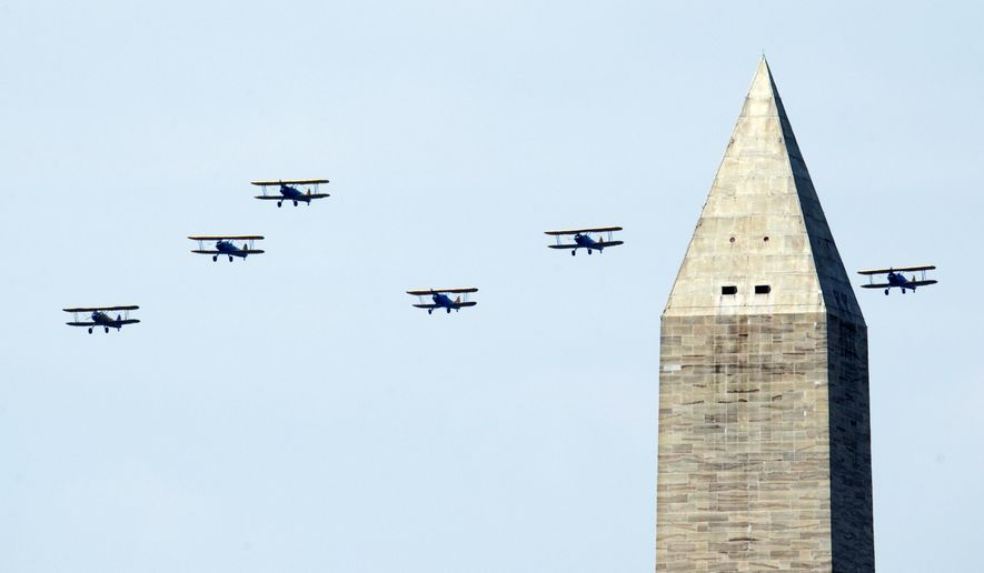 World War II vintage aircrafts flyover near the Washington Monument over Washington, Friday, May 8, 2015, marking the 70th anniversary of the end of the war in Europe on May 8, 1945, and commemorate the Allied victory in Europe during World War II. (AP Photo/Manuel Balce Ceneta)