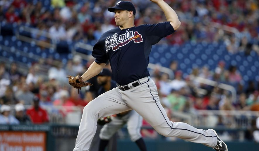 Atlanta Braves starting pitcher Eric Stults (37) throws during the third inning of a baseball game against the Washington Nationals, Friday, May 8, 2015, at Nationals Park in Washington. (AP Photo/Alex Brandon)