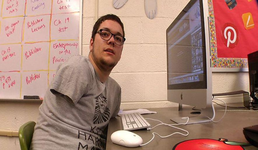 This video frame grab provided by KSTP-TV shows 18-year-old Parker Sebens during an interview with KSTP-TV in a computer lab at Milnor Public School in Milnor, N.D.  Sebens who lost both arms in a farm accident 15 years ago is graduating high school and preparing for college in Minnesota. Sebens fell into a running grain auger on the family farm near Milnor, in far southeastern North Dakota, in September 2000, when he was 3 years old. He spent 54 days in a medical center near Minneapolis, where he went through more than 50 hours of surgery before an infection forced doctors to amputate his arms. (KSTP-TV/Lee Zwiefelhofer via AP) MANDATORY CREDIT