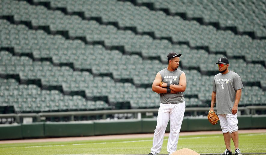 Chicago White Sox first baseman Jose Abreu, left, and left fielder Melky Cabrera, right, talk during batting practice before an interleague baseball game againstthe Cincinnati Reds in Chicago, Friday, May 8, 2015. (AP Photo/Jeff Haynes)