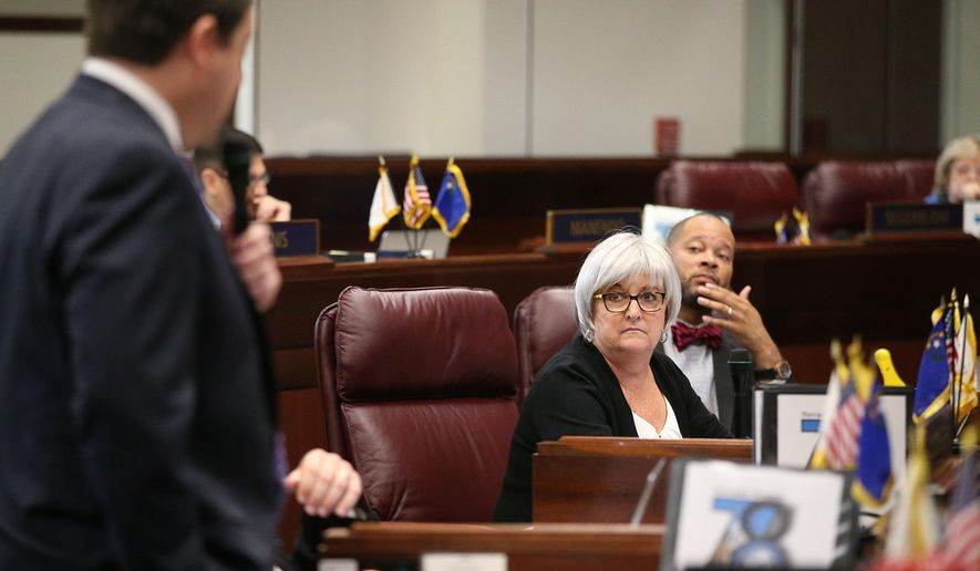 Nevada Senate Democrats Debbie Smith and Aaron Ford listen to Majority Leader Michael Roberson, R-Henderson, during Senate floor debate at the Legislative Building in Carson City, Nev., on Friday, May 8, 2015. Lawmakers voted down a bill allowing for ride-hailing companies like Uber and Lyft in a 13-7 vote that was one vote short of the two-thirds majority needed to pass. (AP Photo/Cathleen Allison)