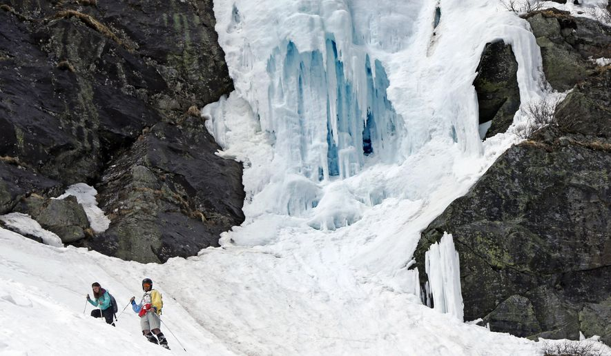 In this Sunday, May 3, 2015 photo, ice clings to a cliff at Tuckerman Ravine on Mount Washington in New Hampshire. Avalanches, falling ice, crevasses and undermined snow are some of the dangers faced by backcountry skiers at the birthplace of extreme skiing. (AP Photo/Robert F. Bukaty)