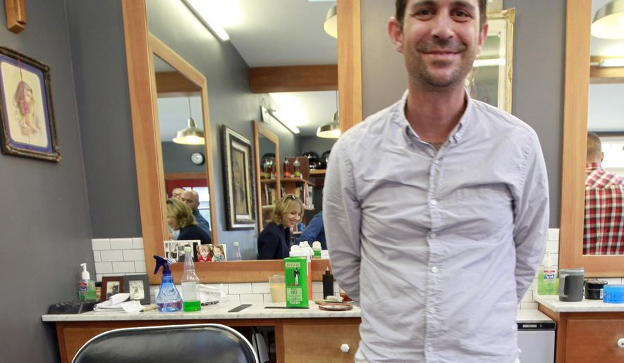 In this Oct. 17, 2014 photo, Nick Vlahos poses at his barber shop in Oakland, Calif. A man who went missing with his young children in a rugged area of Northern California said he spent more than two days trying to get rescuers' attention by putting pink blankets in trees and leaving bottles by a river. Vlahos, 41, said he and his 5-year-old son and 3-year-old daughter also tried to attract notice by lighting fires and putting out lots of yellow straps. The family got stranded Tuesday, May 5, 2015, in the Tahoe National Forest after they went off-roading and their truck became stuck.(Laura A. Oda/Bay Area News Group via AP)