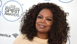 Oprah Winfrey arrives at the 30th Film Independent Spirit Awards in Santa Monica, Calif., in this Feb. 21, 2015, photo. (Photo by Jordan Strauss/Invision/AP/file) ** FILE **