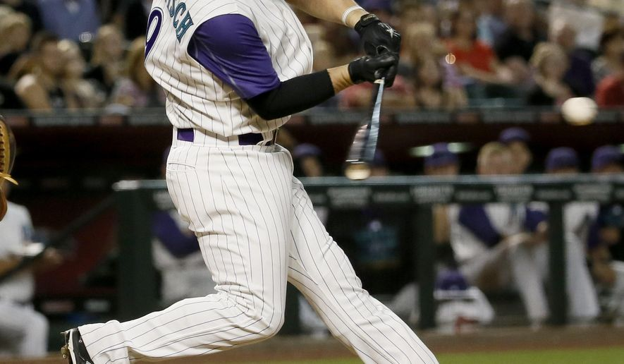 Arizona Diamondbacks' Tuffy Gosewisch hits an RBI double against the San Diego Padres during the third inning of a baseball game, Thursday, May 7, 2015, in Phoenix. (AP Photo/Matt York)