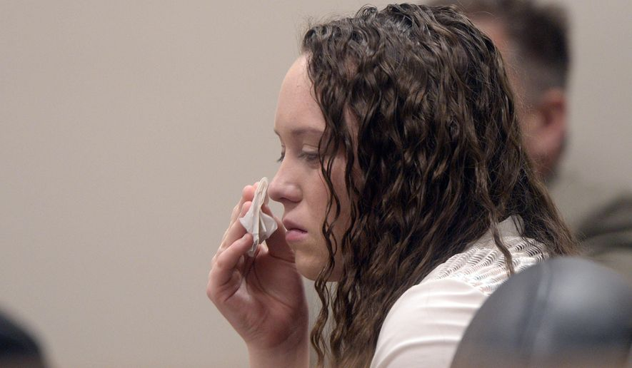 Meagan Grunwald listens to the prosecutor give closing arguments to the jury Friday, May 8, during her trial in Provo. A jury has begun deliberating to decide whether Grunwald, accused in a crime spree that left a deputy dead was violently in love when she drove a speeding getaway car or a terrified victim held at gunpoint by an explosive man.  (Al Hartmann/The Salt Lake Tribune via AP, Pool)