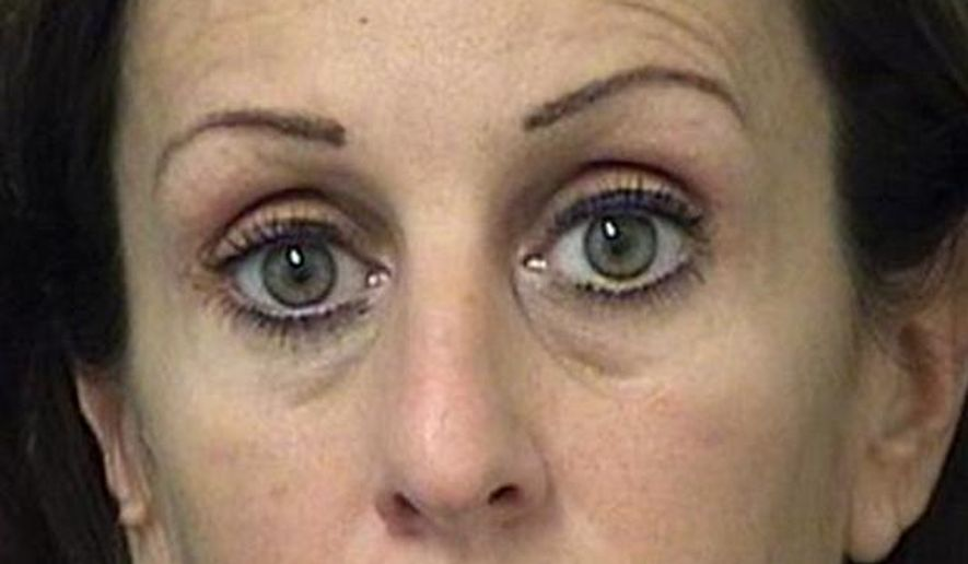This April 2015 booking photo released by the Palm Beach (Fla.) Sheriff's Department shows Krista Eve Morton. Morton, a married Palm Beach County principal has been arrested after she was caught partially clothed in a marijuana-filled car with a student. Morton, of Wellington, was arrested Wednesday, May 6, 2015, in Palm Springs. She is the principal at Mavericks High of Palm Springs, a charter school. (Palm Beach (Fla.) Sheriff's Department via AP)