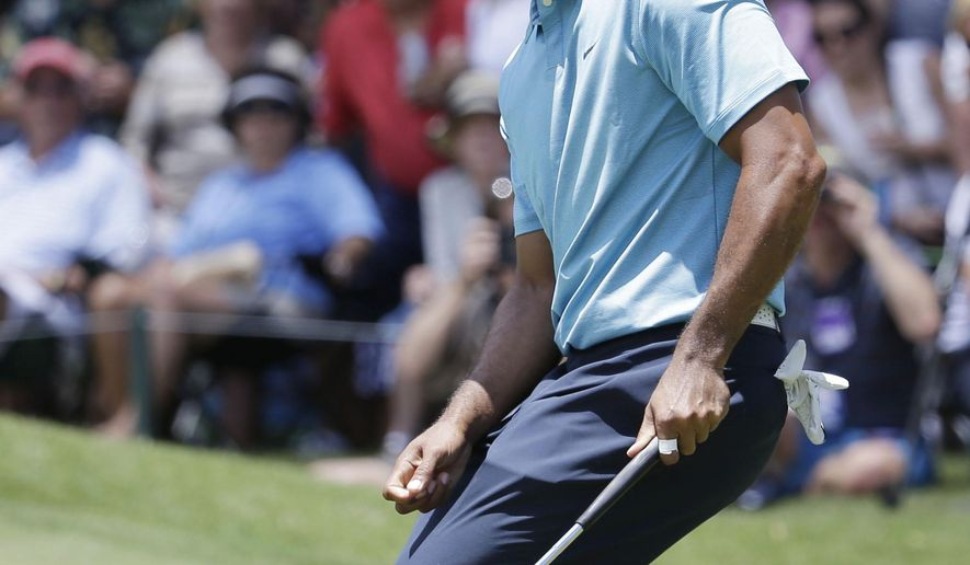Tiger Woods reacts to a missed putt on the eighth hole during the second round of The Players Championship golf tournament Friday, May 8, 2015, in Ponte Vedra Beach, Fla. (AP Photo/Lynne Sladky)